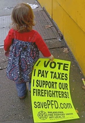 This little girl hold one of the Local 22 campaign signs.