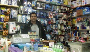 Discount shopping on North Broad Street dominates. Dollar Discount owner and Bangledesh immigrant Jahed Chowdheury hopes discount prices and Muslim items will attract customers.