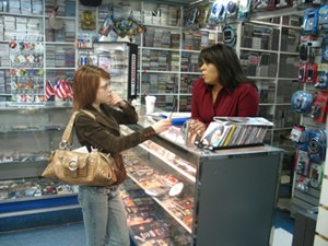 Reporter Maureen Coulter talks with Quetzy Lozada, the office director of the 7th Council District. Photo By Marcos Rios.