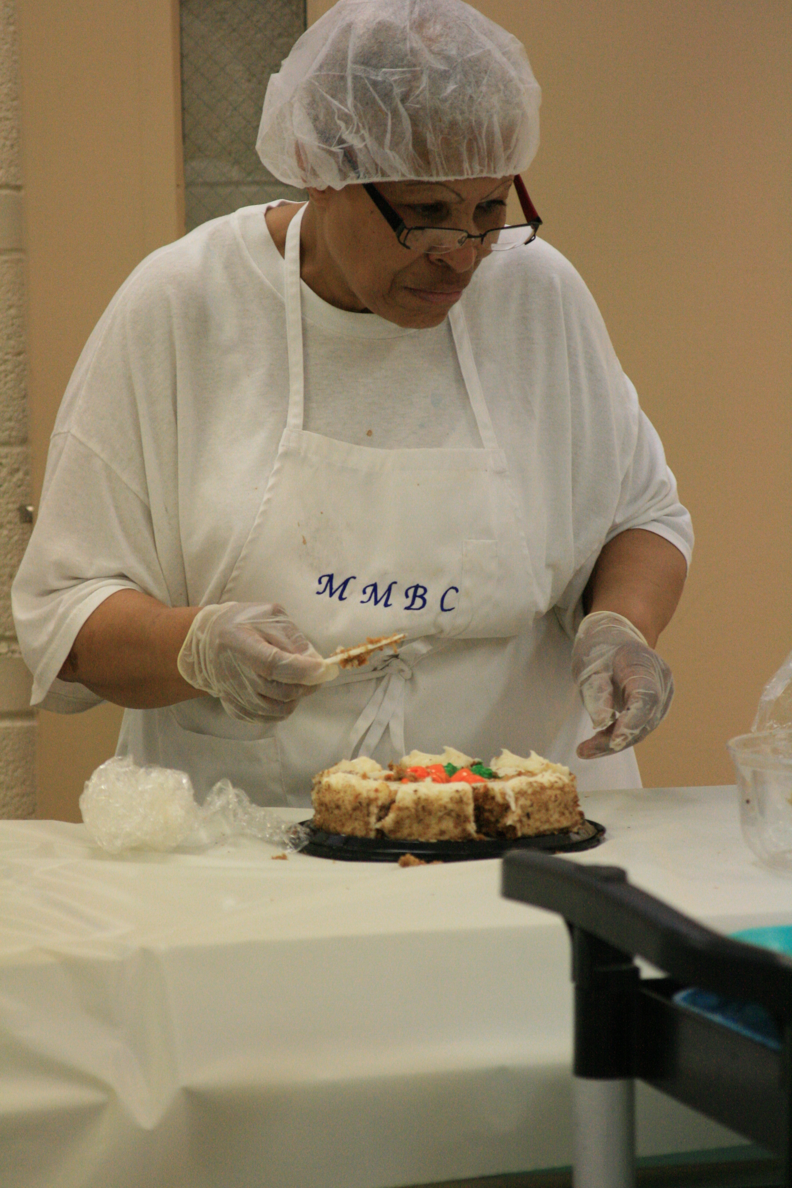 Deaconess Sarah Lynch preparing the afternoon's desert.