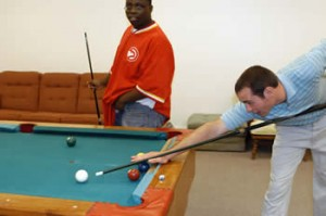 After the Bible study, Mike and Denzel find time for a game of pool.