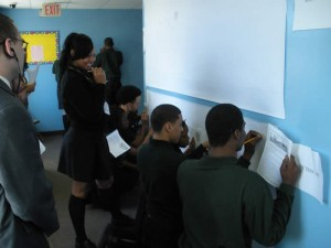 Students working on a Holocaust timeline outside the history room