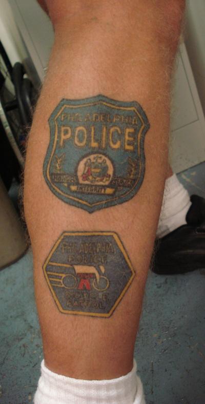 Police tatoos adorn Sgt. Spriggs' body.