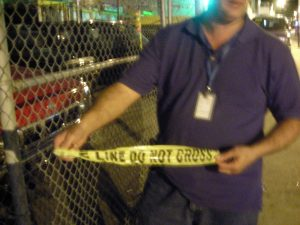 Bucceroni on a nightly patrol of the area, showing a piece of police tape where seven people were recently shot.