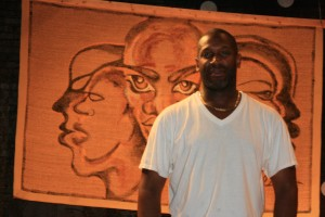 Darien Bagley, the manager at The Arts Garage, in front of the stage in the upstairs part of the venue.