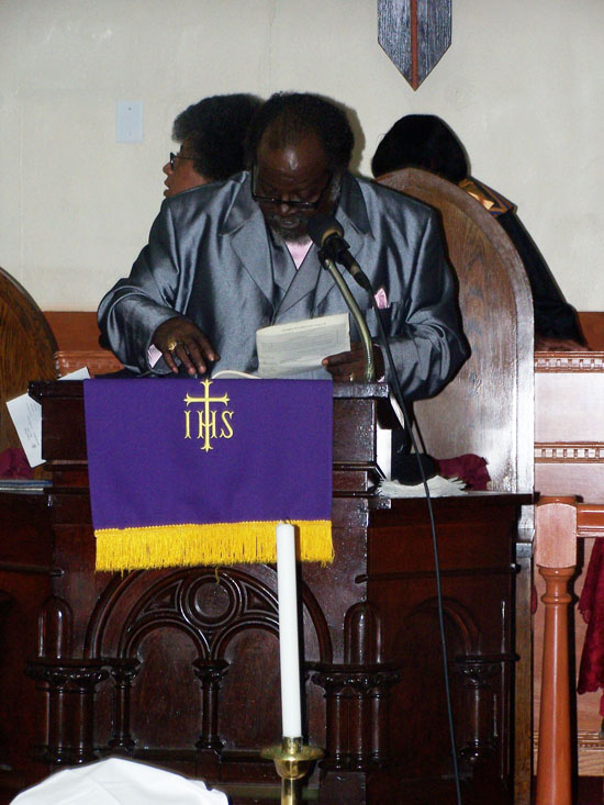Reverend Davis addresses the congregation at Sunday service