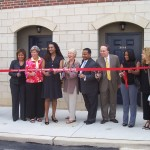 Distinguished guests come together for the ribbon cutting that will improve the living conditions of 40 families.
