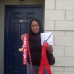 Marquita Irby stands proudly outside of her new home.