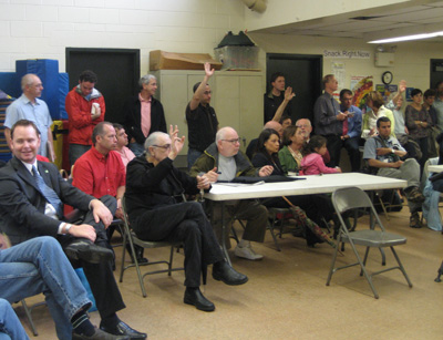 Neighbors and community leaders discuss the mob problem.