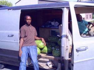 Savaughn and Elijah sit in the work van
