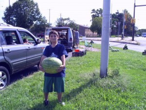 Kid struggles to hold large watermellon