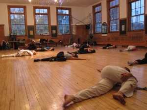 Students stretch before more exercises