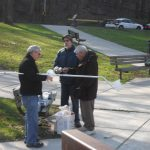 Dr. Chun and company prepare the tools necessary to collect water samples of Germantown's Saylor Grove.