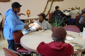 Margaret Shepherd passes out flyers for Saving Homes Saving Neighborhoods to seniors in West Oak Lane