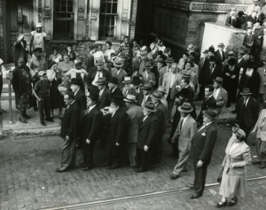Mourners leave a synagogue in the early 50's.