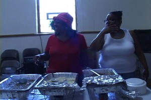 Church members and volunteers prepare to serve food to the needy.