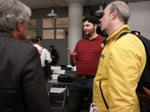 Michael Becker speaks to meetup attendees after the DataPhilly presentation.