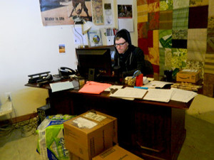 Circle of Hope worker sat at his desk working.