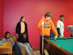 Junior high students hung out and played games at the Teen Center last Friday night.