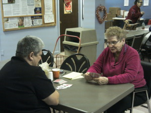 Susan Bader-Desparios (left) and June Mills enjoy playing card games together.