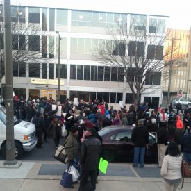 A large crowd gathered in front of the School District of Philadelphia headquarters to protest the closing of 29 public schools.