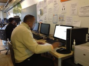 Odell Foster, community intern at the Free Library of Philadelphia works in the internet hotspot.