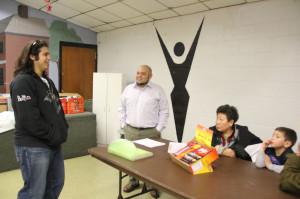 Alberto Rivera (center) prepares to propose his duplex ideas.
