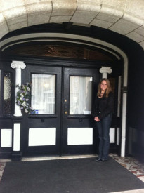 Betty Ann Guckin stood outside of her funeral mansion.