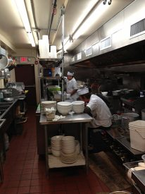 Chefs cleaning up after the lunch rush.