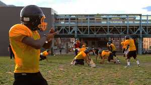 The Tigers practice under the Berk El stop and hope to transform their practice field into a varsity stadium by 2014.