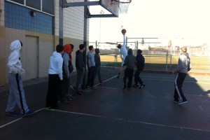 Boys from the community played basketball following an indoor soccer game.