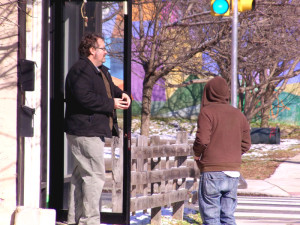 Highwire Gallery employee Steve Tobin (left) stands outside the business located next to the empty lot.