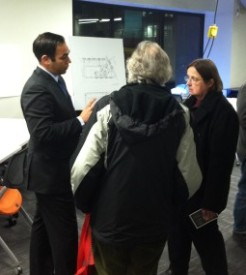 Matt Stein (left) from American Campus Communities explained the proposed neighborhood layout to concerned local residents.