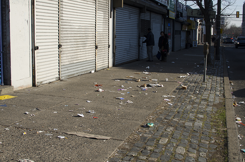 Kim Sun opens his store early in the morning only to find his sidewalk full of litter.
