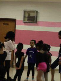 V. Renee Price teaching her beginner's ballet class.