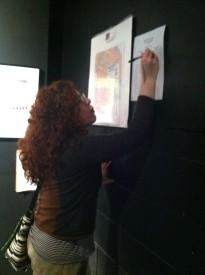 Local resident GiGi Lamm makes the first bid on the showcased art work.