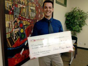 Esperanza's Philip Dawson presents check from its Wells Fargo grant.