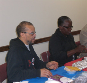 Volunteers ate lunch and had a fellowship meeting after serving participants in the Philabundance food program.