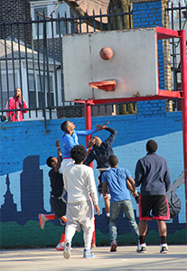 Children from various parts of West Philadelphia set aside neighborhood differences to play basketball on the courts of Tustin Recreation Center.