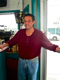 Anthanasiadis stood in his shop, El Greco Pizza & Luncheonette.