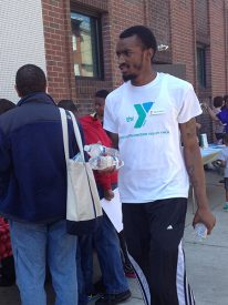 Tappe passed out waters to people at Healthy Kids Day.