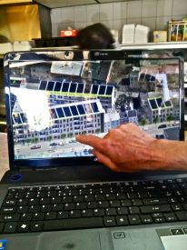 Anthanasiadis points to his computer screen, a daily reminder of what the AACDC will be doing with his properties.