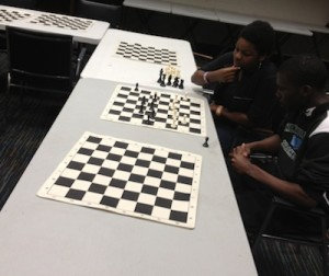 Two Lenfest kids get ready for chess club with a practice match.