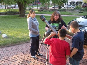 Denise Vacca assisted children as they looked through the telescope.