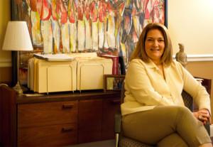 Anne Hagan sat in her new office.