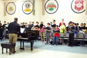 The Philadelphia Boys Choir directed by John Stroud practiced in the new building.