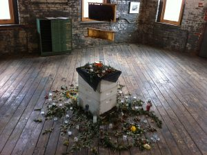 "Elisa Esposito's centerpiece, ""Collapsed Colony,"" shows the sudden death of a colony of bees."