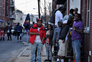 """A group of young people enjoying the atmosphere of the """"QuiteHype Cookout""""."""