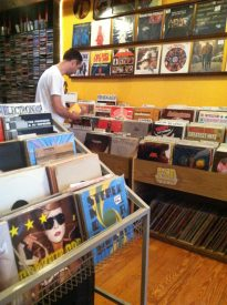A customer at Marvelous browses through the vast collection of records Marvelous has for sale.