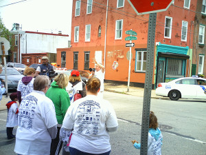 A.J. Thomson announced the directions of the 5K to the runners.